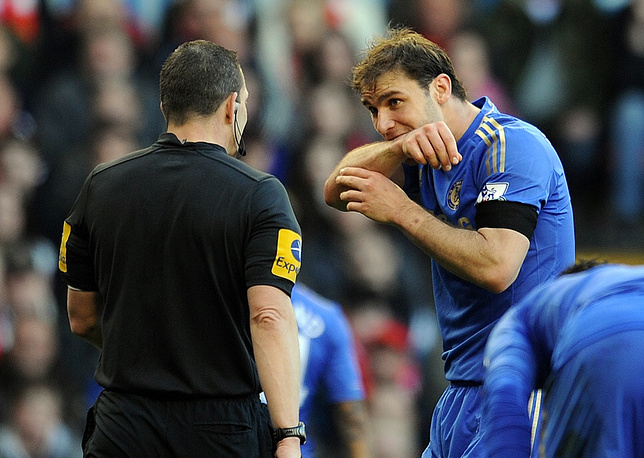 Luis Suarez was punished with a 10-match ban. Photo: Branislav Ivanovic shows the place of bite
