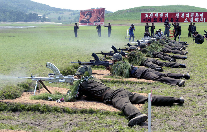 North Korean soldiers practice shooting during a ceremony to mark the Korean War anniversary on June 25