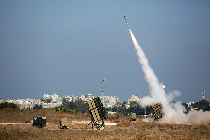 An Israeli Iron Dome defense system missile is fired to intercept a rocket fired from Gaza