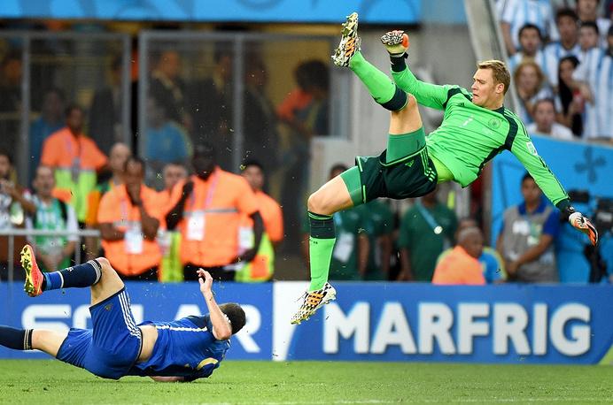 Argentina's striker Gonzalo Higuaín falls being hit by German goalkeeper