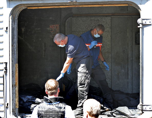 Bodies of the MH17 victims were transported to the railway station of Torez and loaded into  refrigerated train cars