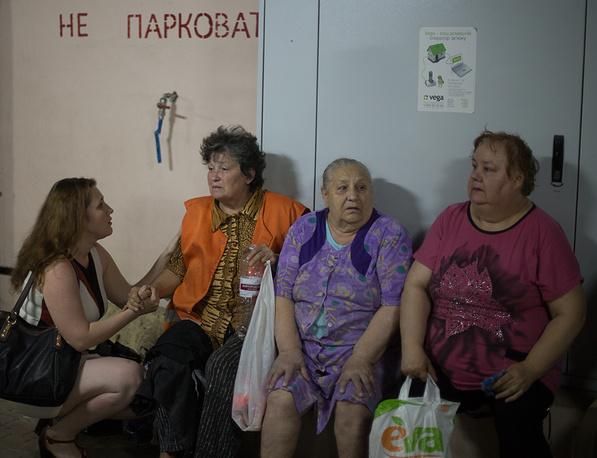 Civilians hide in shelters
