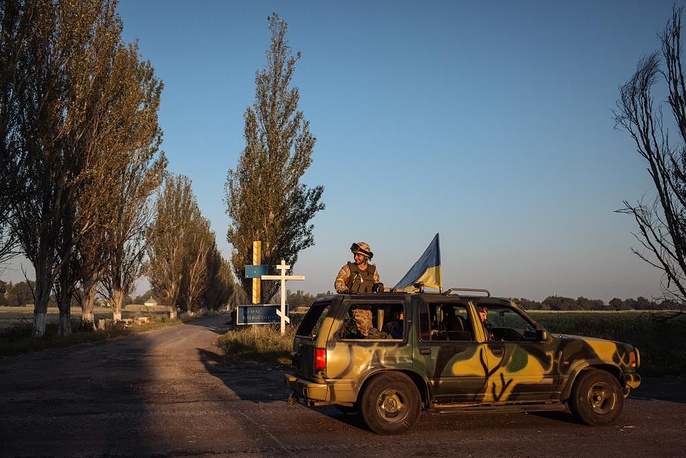 A military jeep of the Ukrainian army before a battle against militia not far from Donetsk