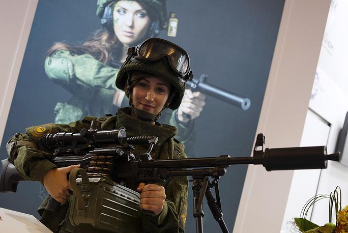 A young woman with a Pecheneg SP light machine gun