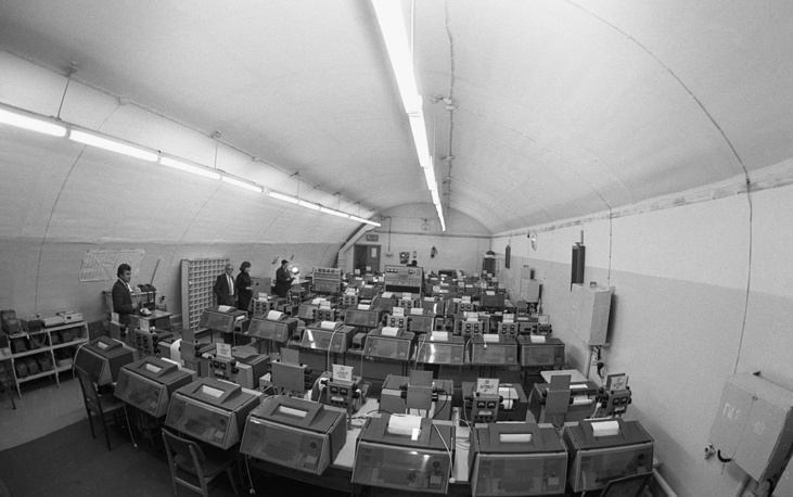 "The reserve center of the Telegraph Agency of the Soviet Union is located at the depth of 50m. It can only be opened in case of the emergency command, when ""there is a threat to the agency's operations"". Pictured: the instrument room for international connections, 1991"