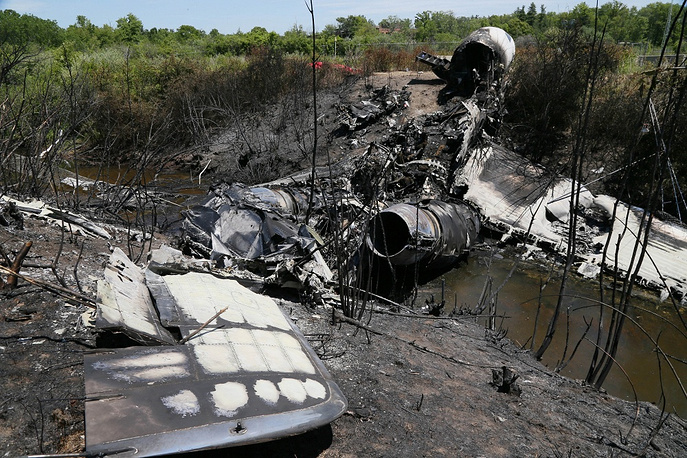 Lewis Katz and six other people died in the crash on 31 May 2014. Photo: Wreckage lies at the scene, June 2, 2014, in Bedford, Massachusetts, where a plane plunged down an embankment and erupted in flames during a takeoff attempt