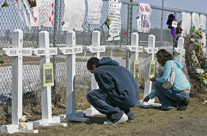 Red Lake shooting took place on March 21, 2005 in two places on the Red Lake Indian Reservation, Minnesota, United States. 16-year-old Jeffrey Weise killed two relatives and later went to school where he killed seven people and wounded five others. Photo: A memorial outside the Red Lake Senior High School in Red Lake, March 25, 2005