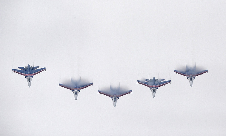 Russian Knights' Su-27 airplanes keep a minimum distance of 3 meters during a performance