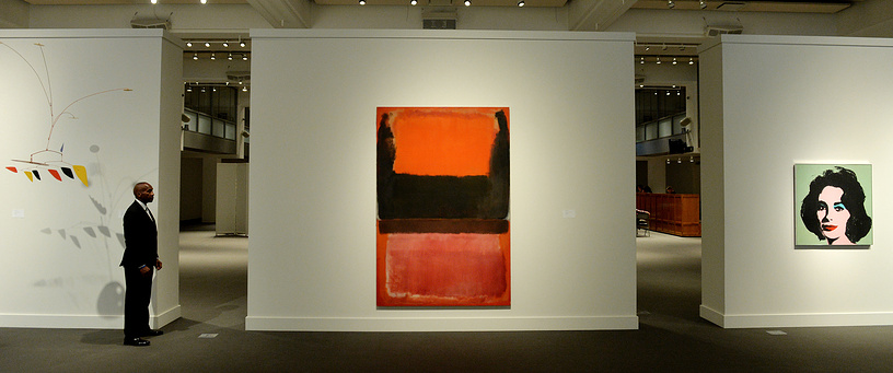 """Mark Rothko painting No. 21 (Red, Brown, Black and Orange, pictured centre) was sold at Sotheby's auction in New York for $45 million on November 11. Another highlight was Jasper Johns' """"Flag."""" It brought in $36 million, a record for the artist's work at auction. Andy Warhol's portrait of Elizabeth Taylor (right) fetched $31.5 million"""