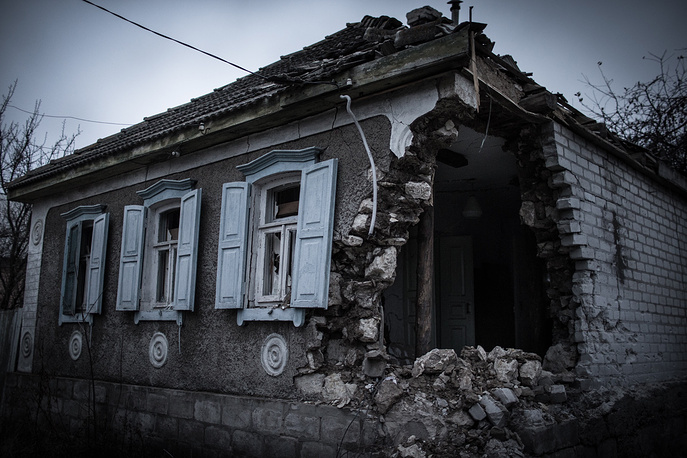 According to OSCE report, some 2,400 houses damaged and need repair in Luhansk region. Photo: A house in Luhansk region destroyed in a shelling attack by the Ukrainian government's troops
