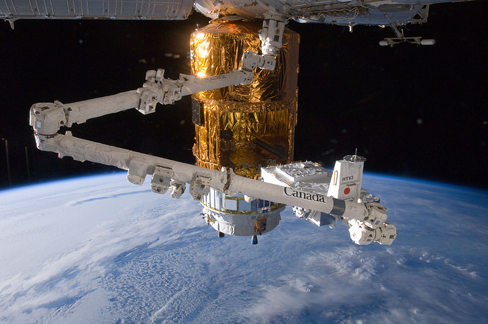 Canadarm2 plays a key role in station assembly and maintenance. Photo: The grasp of the International Space Station's robotic Canadarm2, 2012