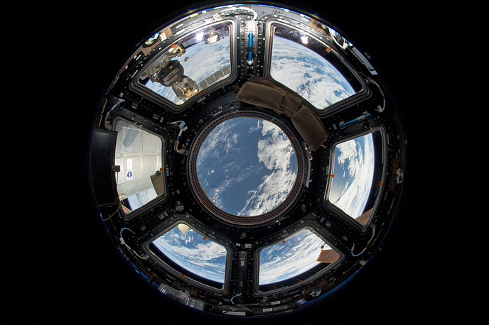 Cupola is a seven window observatory, used to view Earth and docking spacecraft. Photo: A fisheye lens view of planet Earth seen from the Cupola on the Earth-facing side of the ISS, 2013