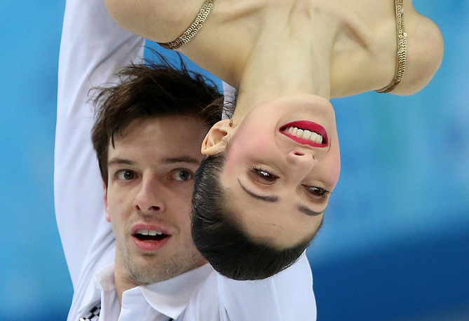 Italy's Stefania Berton and Ondrej Hotarek skate during the team event pair short at the Sochi Olympics