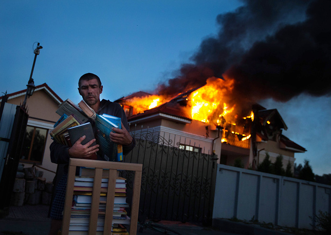 A house on fire after a mortar attack in the outskirts of Lugansk