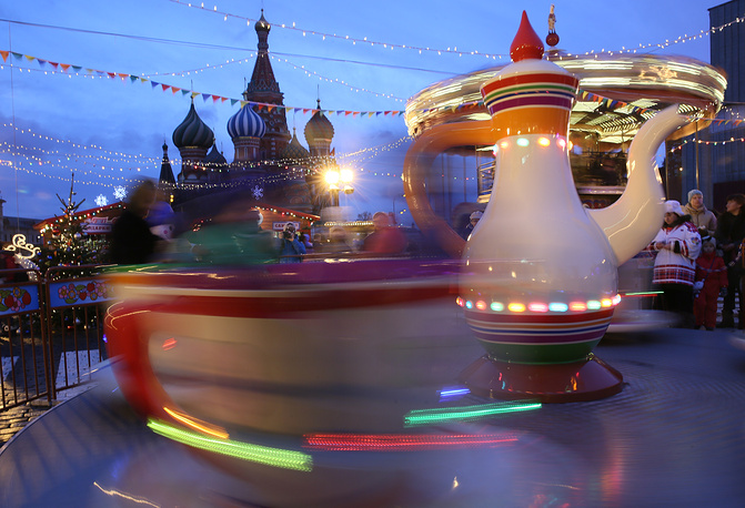 Children on a merry-go-round in Moscow's Red Square