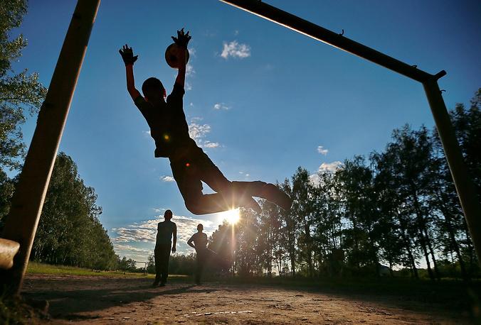 Children play football in a village in the Kostroma Region