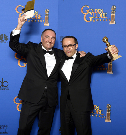 Russian director Andrev Zvyagintsev and Russian producer Alexader Rodnyansky with their award for Best foreign language film for 'Leviathan'