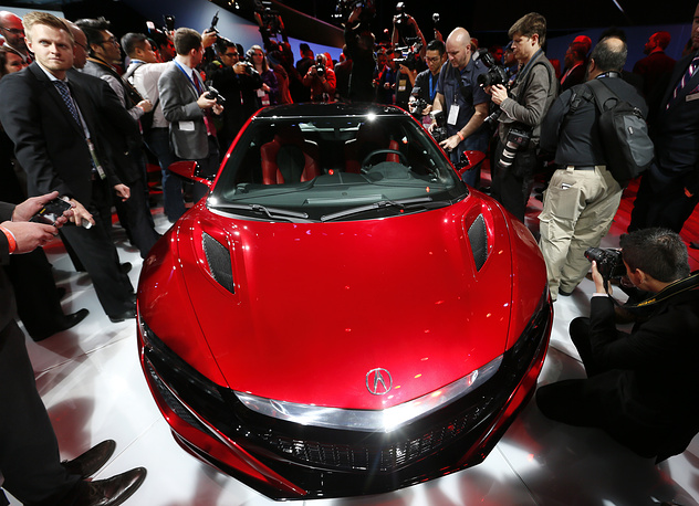 Media surround the Acura NSX at its debut