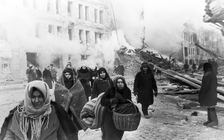 Residents leaving their destroyed houses
