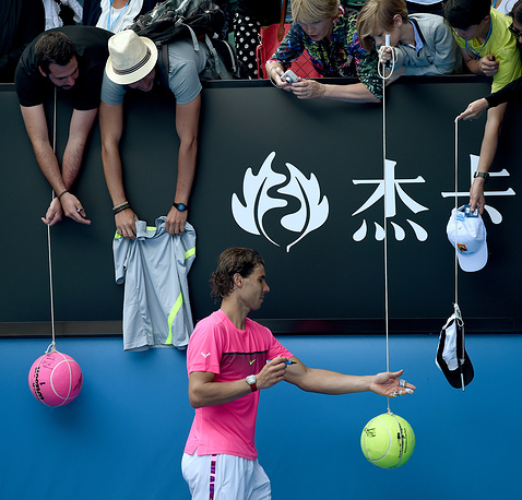 Record for the last 10 years was set in 2012, when 686006 spectators watched the matches. Photo: Spain's Rafael Nadal signs autographs for fans after his win against Russia's Mikhail Youzhny in their first round match at Rod Laver Arena during the Australian Open at Melbourne Park, 2015