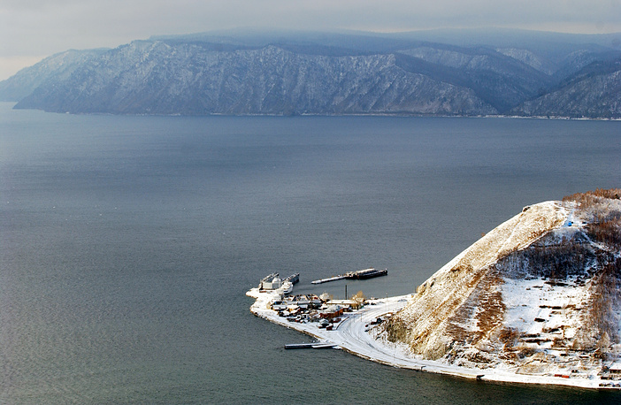 Situated in south-east Siberia, the Lake Baikal is the oldest and deepest freshwater reserve in the world. Photo: View of lake Baikal and Port Baikal village