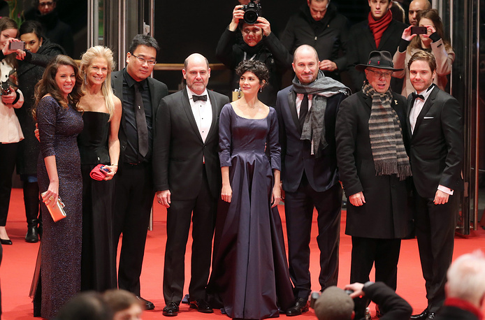Berlinale director Dieter Koslick and members of the International Jury (from left to right) Peruvian director Claudia Llosa, US producer Martha de Laurentiis, South Korean director Bong Joon-ho, US director Matthew Weiner, French actress Audrey Tautou, President of the jury and US director Darren Aronofsky and German actor Daniel Bruehl at the opening gala of the 65th Berlin Film Festival