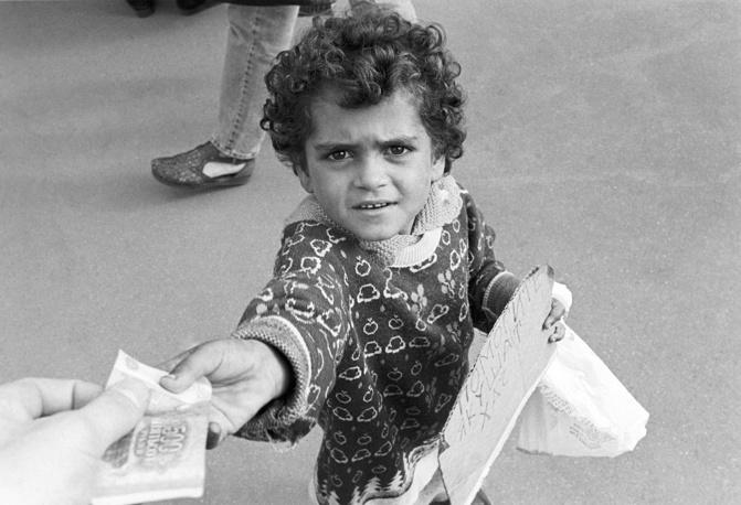 Gypsy boy begging at Kiev railway station in Moscow, 1996