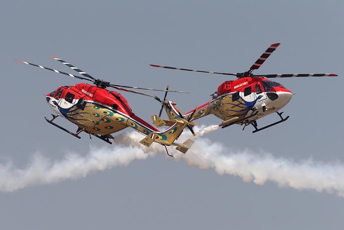 Sarang aerobatic team piloting Druhv helicopters performing at the Aero India 2015