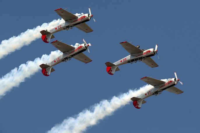Yakovlev Yak-52 aircrafts performing a demonstration flight