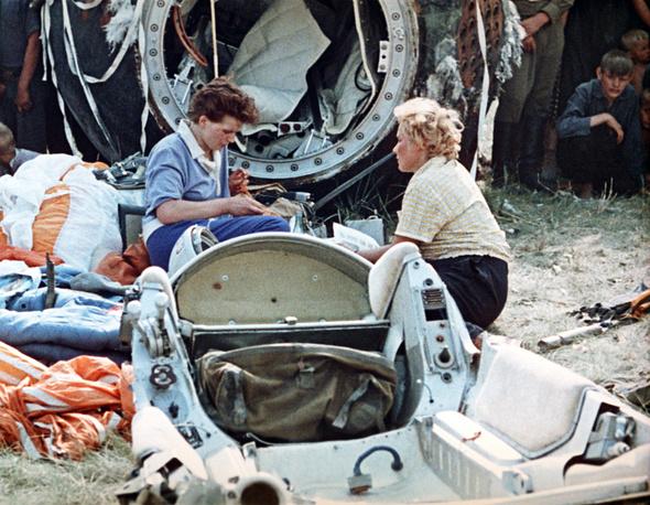 Photo: Valentina Tereshkova (center) after landing