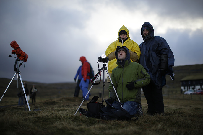 People waiting for the start of a total solar eclipse in Torshavn, the Faeroe Islands