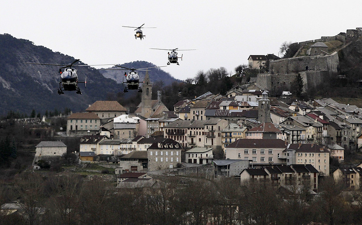 Flight 4U 9525 was travelling between Barcelona and Dusseldorf, coming down in a remote area of the French Alps. Photo: Helicopters of the French gendarmerie and emergency services flying over Seyne-les-Alpes as they resume works to recover the bodies and the remains of the Airbus A320 that crashed the previous day in French Alps France