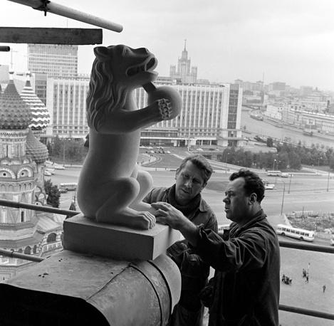 Stonemasons during repair work on the Spasskaya Tower of the Moscow Kremlin, 1974