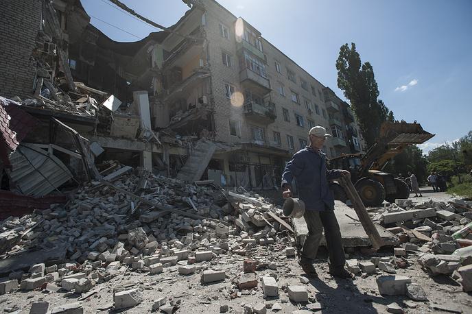 Aftermath of a shelling in Mykolaivka, eastern Ukraine, July 2014