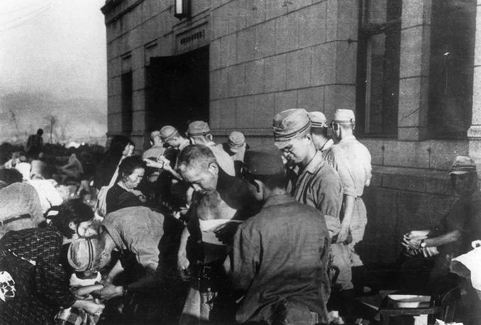 Over years the radiation sickness claimed another 152,000 lives. Photo: Survivors receiving emergency treatment by military medics shortly after the first atomic bomb was dropped by the United States over the Japanese city of Hiroshima