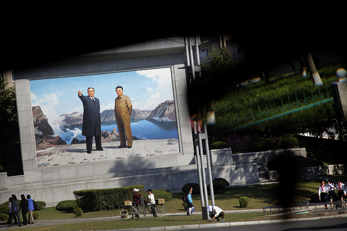 Today, Pyongyang is the main commercial, industrial, cultural and administrative center of North Korea. Photo: portrait of Kim Il Sung and Kim Jong Il on a street corner in Pyongyang