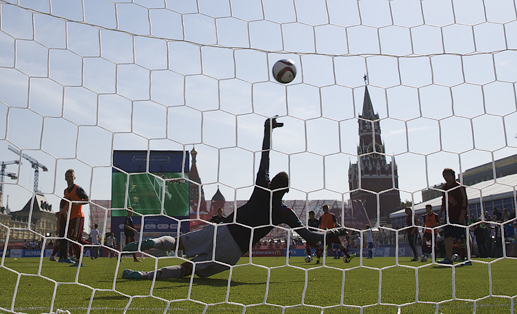 A goalkeeper trying to save the ball at a soccer park installed at Red Square in Moscow, Russia