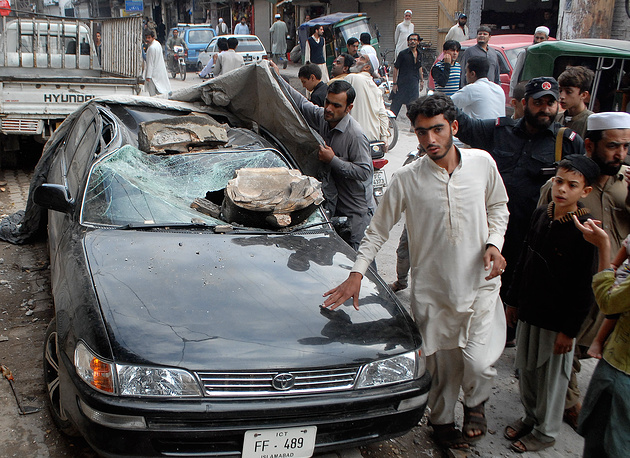 Car damaged from an earthquake in Peshawar, Pakistan