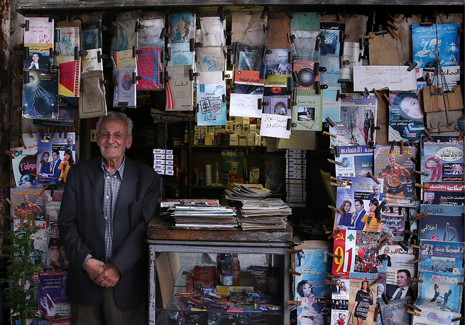A newspaper and book stall in a street in Damascus