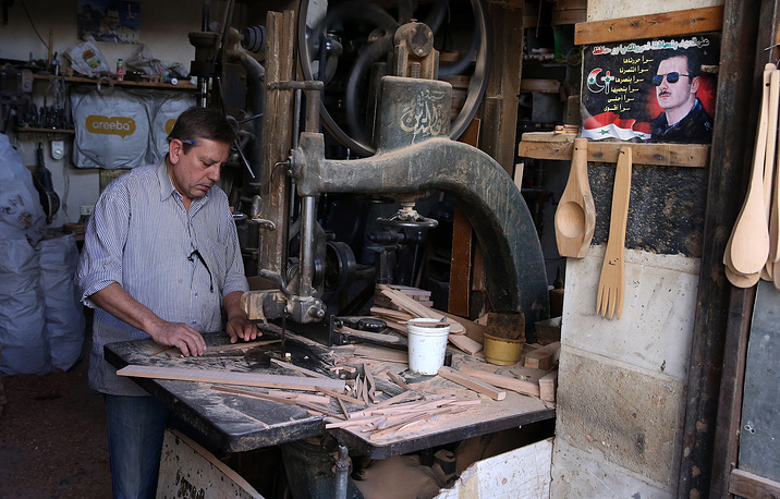A craftsman in the old city of Damascus