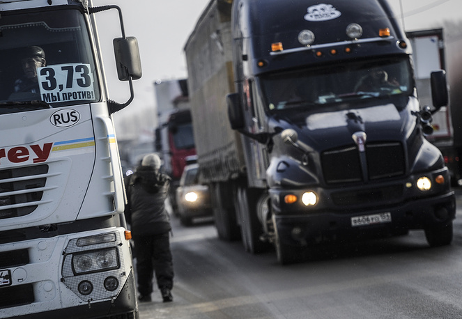 Long-distance truck drivers protesting against the introduction of a kilometer charging system for the vehicles over 12 tonnes on the Irtysh R-254 federal highway