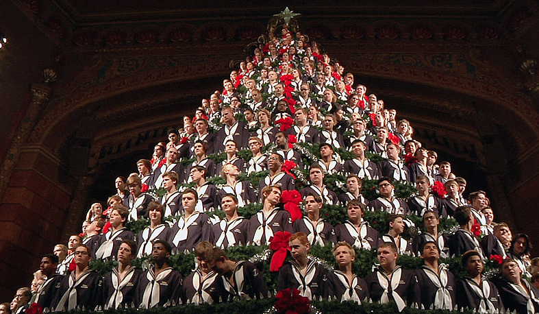 Members of the Mona Shores High School Choir standing in the Singing Christmas Tree at the Frauenthal Center in Muskegon, USA