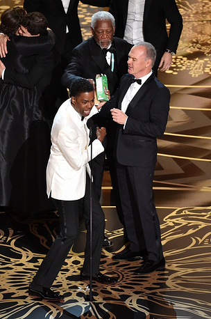 Host Chris Rock, actors Morgan Freeman and Michael Keaton celebrating onstage during the 88th Annual Academy Awards