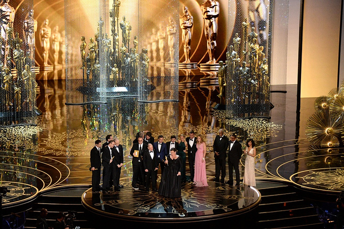 Cast and crew of 'Spotlight,' including actors Brian d'Arcy James, Michael Keaton, writer-director Tom McCarthy, actor Mark Ruffalo, producers Nicole Rocklin and Blye Pagon Faust, screenwriter Josh Singer, producer Michael Sugar, actors Rachel McAdams and Liev Schreiber, and producer Steve Golin accepting the Best Picture award