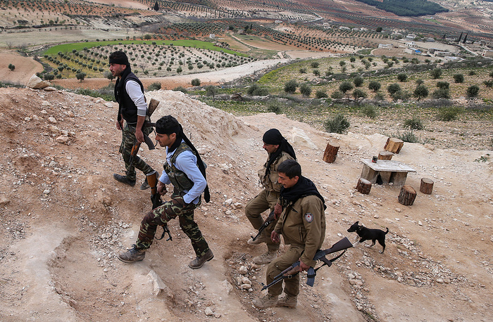 Armed Kurdish fighters near the Syrian-Turkish border