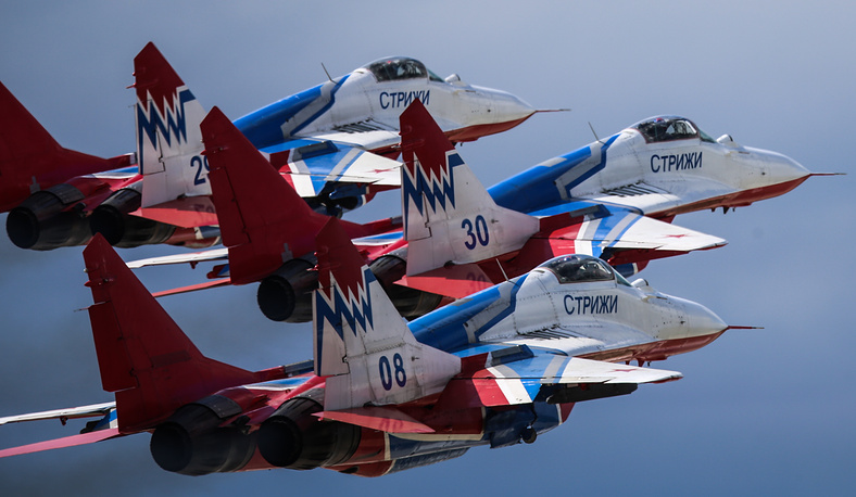 Mikoyan MiG 29 fighter jets of the Strizhi (Swifts) aerobatic team flying over Kubinka, Moscow Region