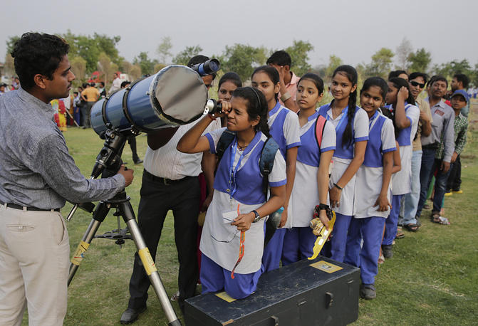 School children looking through a telescope the transit of Mercury across the sun in Lucknow, India. NASA says the event occurs only about 13 times a century.