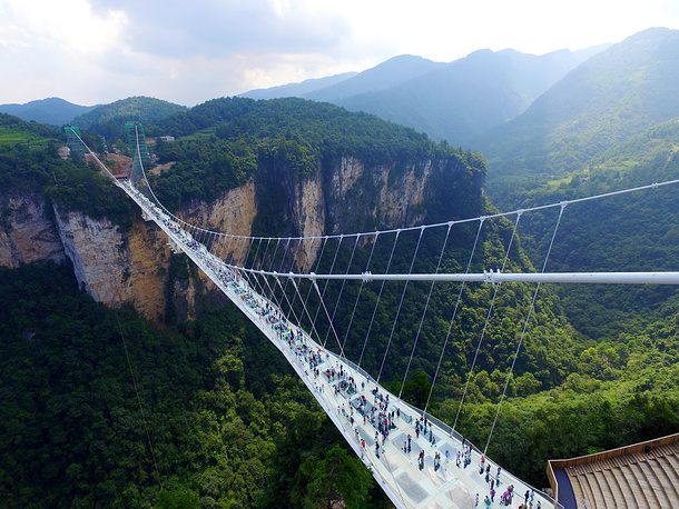 Zhangjiajie Grand Canyon Glass Bridge is the tallest and longest glass bridge ever built. The 375-meters long bridge, featuring 99 pieces of five-centimeter-thick reinforced glass as its floor, spans some 300 meters above the bottom of the Karst valley in the scenic zone