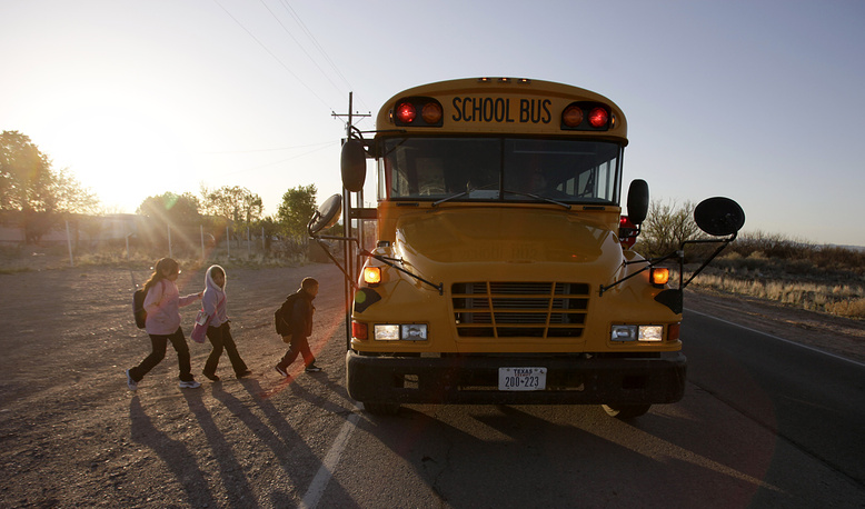School children walking to board a school bus at Fort Hancock, Texas, USA