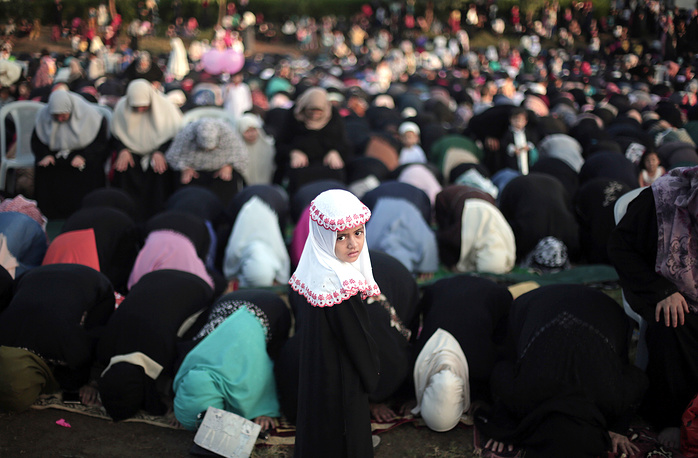 Palestinian Muslims pray in Gaza City